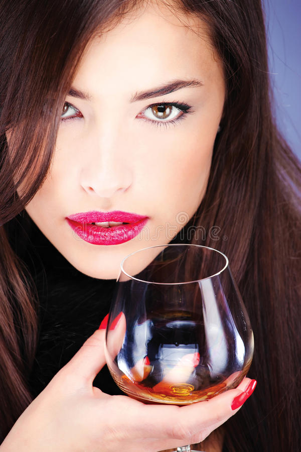 Free Woman With Pelt, Holding Glass Of Brandy Royalty Free Stock Images - 22934869