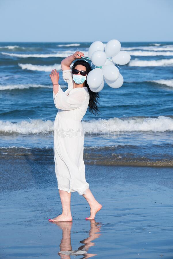 Free Woman With Protective Mask On The Beach Stock Images - 191981904