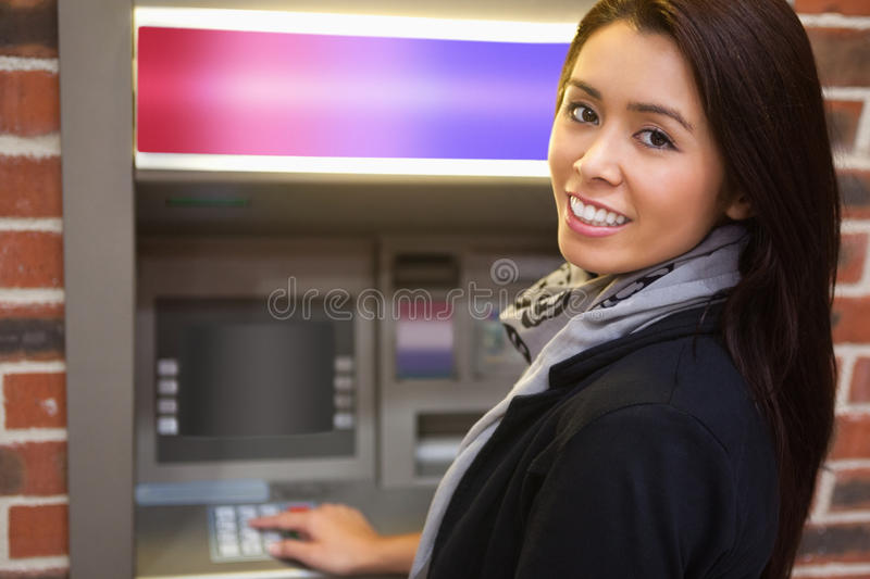 Woman withdrawing cash. At an ATM royalty free stock images