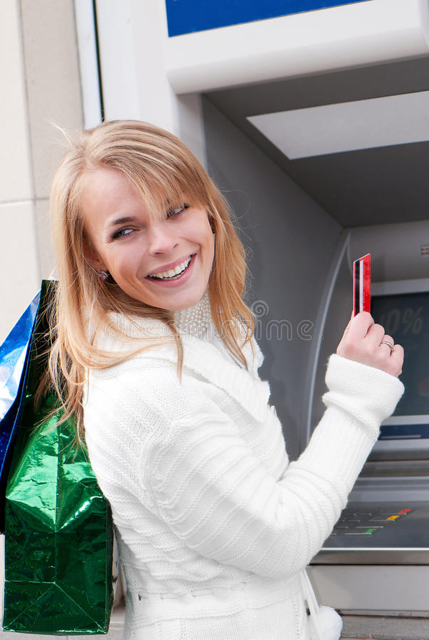Woman Withdrawing Money Stock Photo