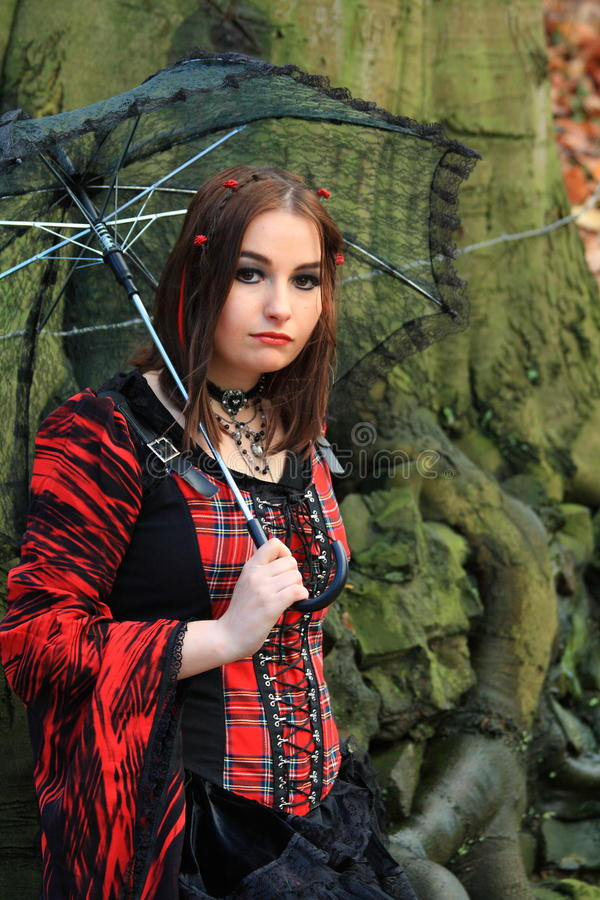Woman In The Woods With Umbrella Stock Photography