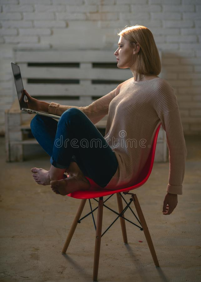 Woman work on computer at home. Girl with laptop keep blog sitting on chair. Agile business and communication. Buy. Online and digital marketing. Businesswoman stock photography
