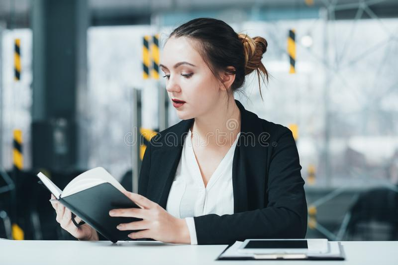 Woman work corporate workplace business executive. Woman at work. Corporate workplace. Business executive checking schedule in day planner royalty free stock image