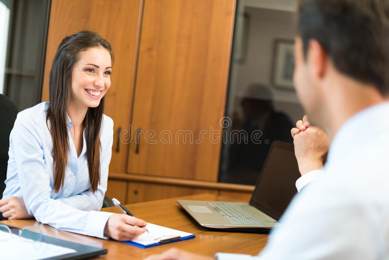 Woman at work in her office royalty free stock image