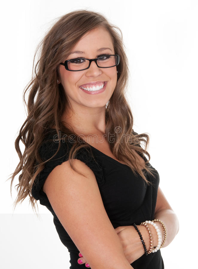 Woman at work smiling. Business woman at work smiling while wearing glasses royalty free stock images