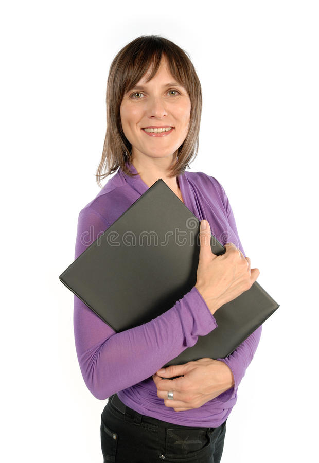 Woman with workbook. Smiling woman holding a workbook stock images