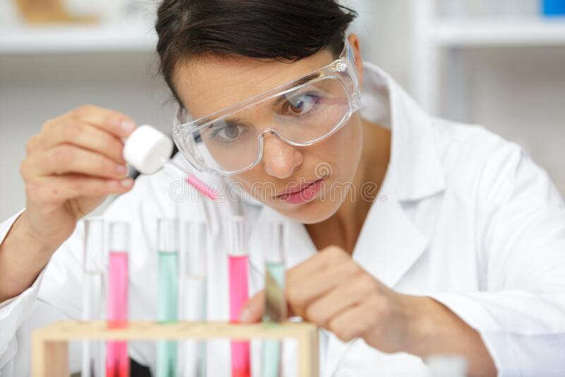 Woman worker holds pipette royalty free stock images