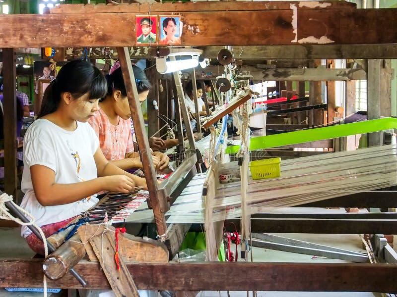Woman workers in Mandalay, Myanmar 2. MANDALAY MAY 23: Burmese weaver do her job in a souvenir factory in Mandalay, Myanmar on May 23, 2014. Mandalay is the royalty free stock photo