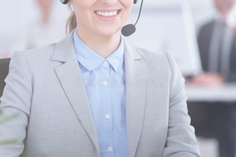 Woman working as telemarketer stock photos