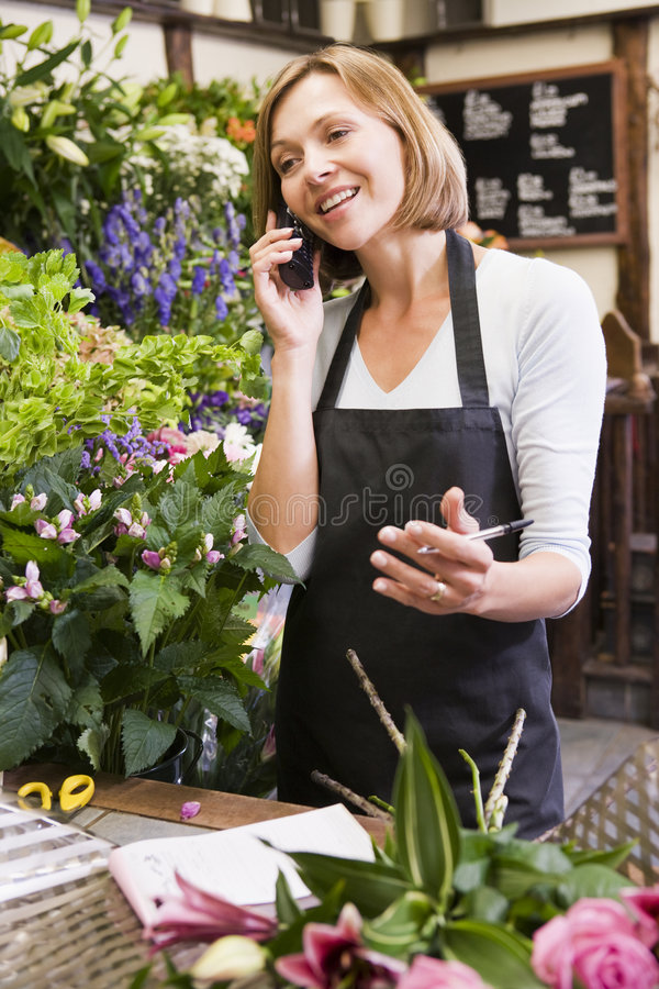 Free Woman Working At Flower Shop Using Telephone Stock Image - 5940421