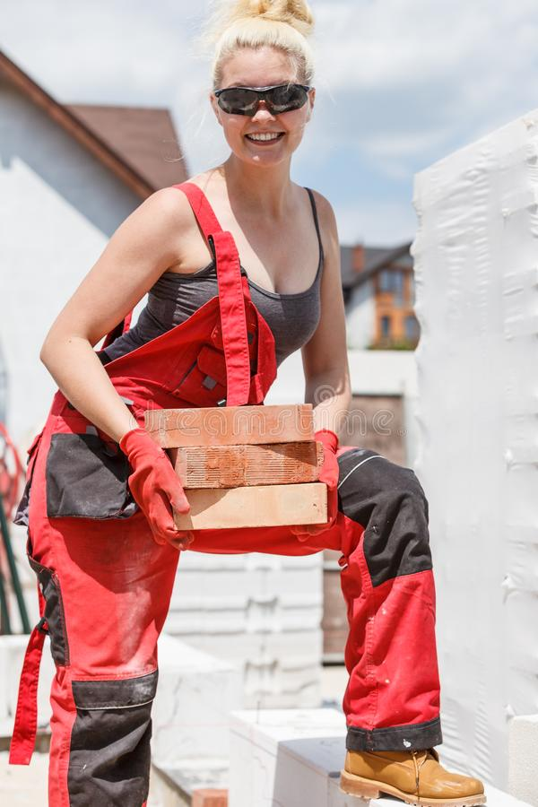 Woman working with bricks royalty free stock photography