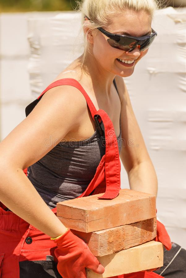 Woman working with bricks stock photo