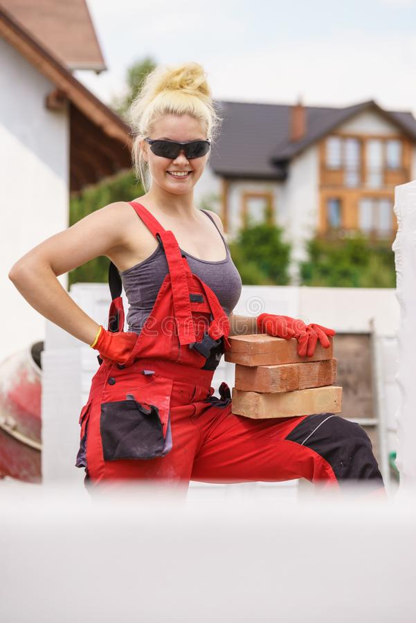 Woman working with bricks royalty free stock image