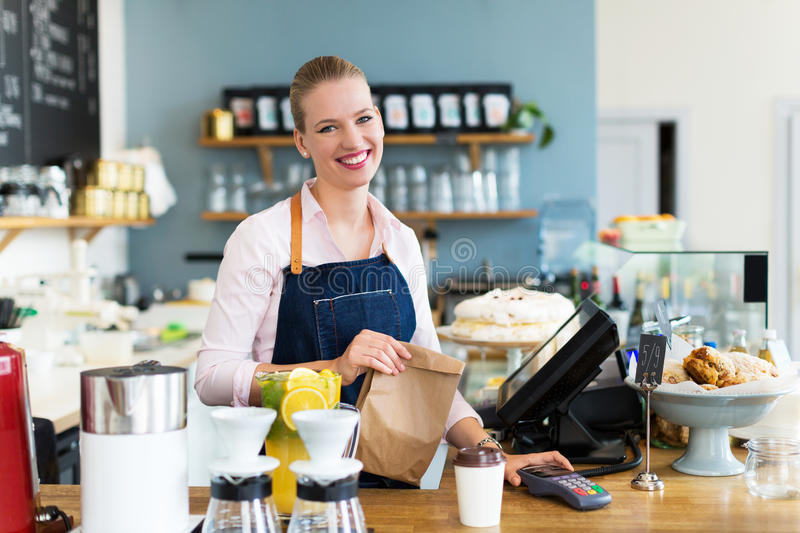 Woman working at cafe royalty free stock photography