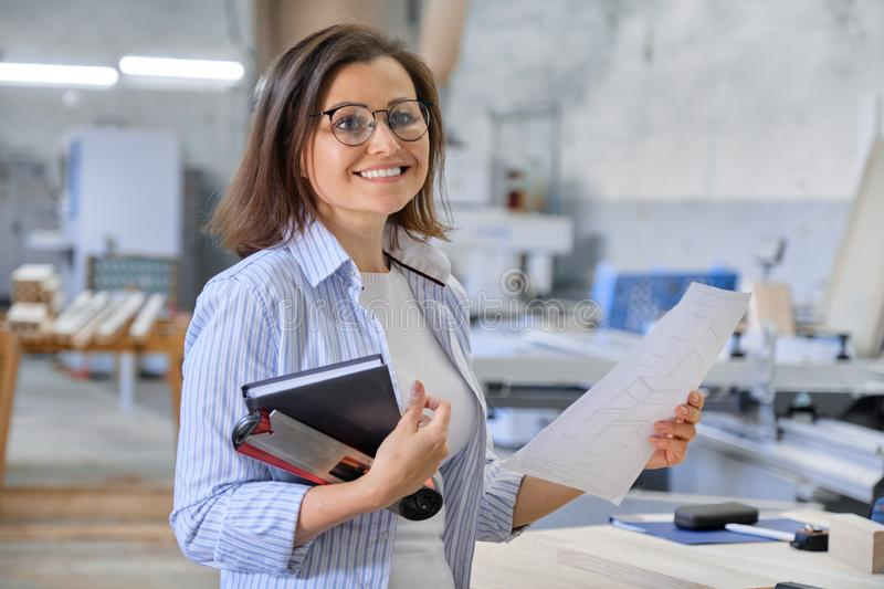 Woman working in carpentry, industrial portrait. Female in woodworking workshop. Woman working in carpentry, industrial portrait. Female designer, manager stock images