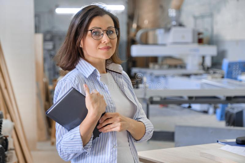 Woman working in carpentry, industrial portrait. Female in woodworking workshop stock photos