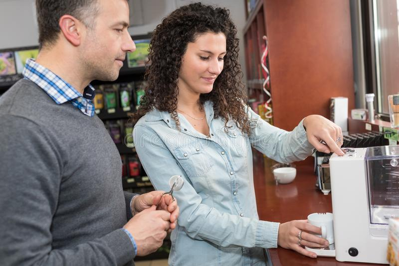 Woman working on coffee factory tasting coffee stock photos
