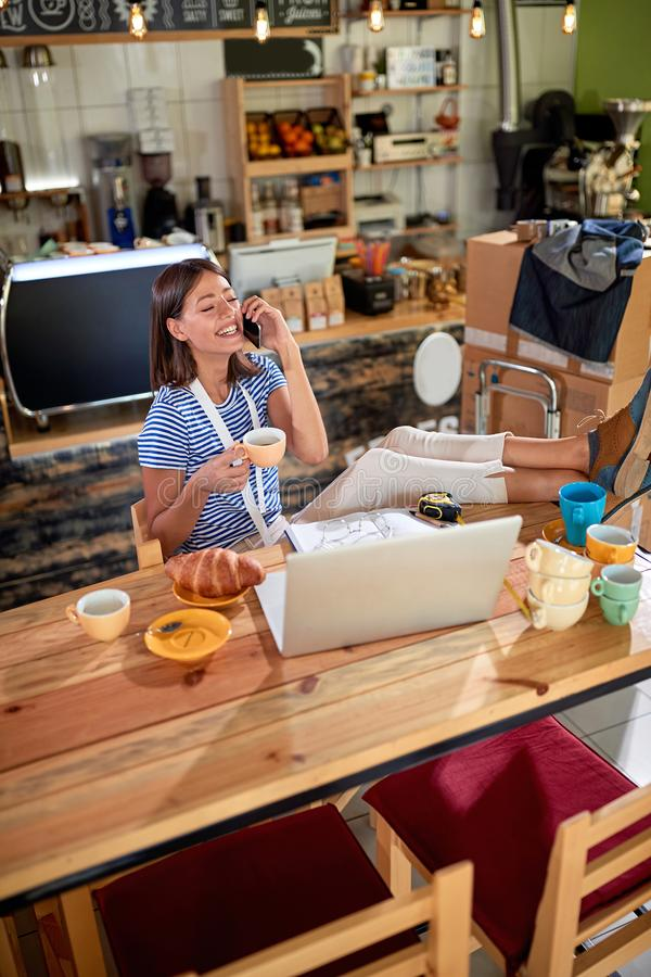 Woman working at coffee shop - Coffee shop owner stock photography