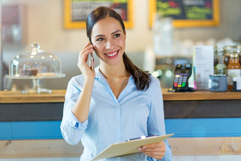Woman working in coffee shop royalty free stock photos