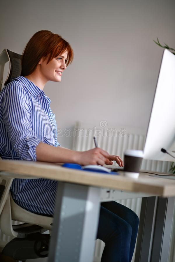Woman working on computer stock photo