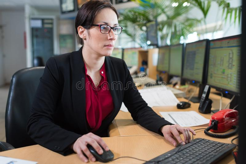 Woman working in control center stock images