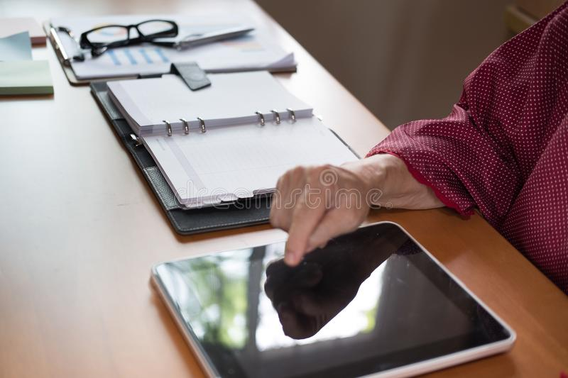 woman working with digital tablet at office. hand pointing on to stock images