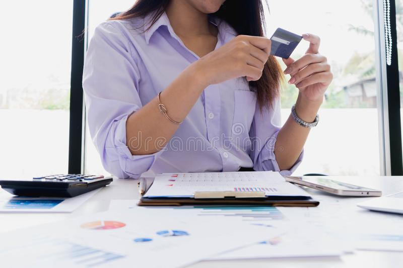 Woman working with documentation, try to relax use credit card for shopping online. Pays for purchase.online shopping, online. Payment, e commerce royalty free stock image