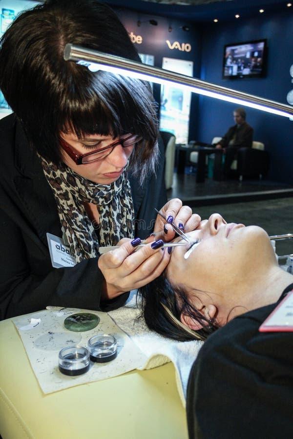 Woman working on eyelash extensions stock photos