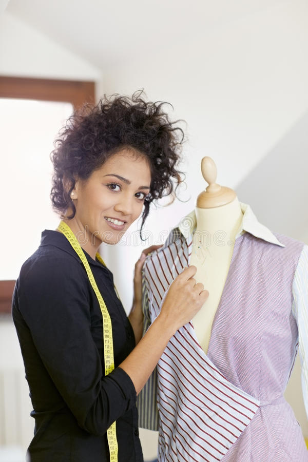 Woman Working In Fashion Design Studio Stock Photo