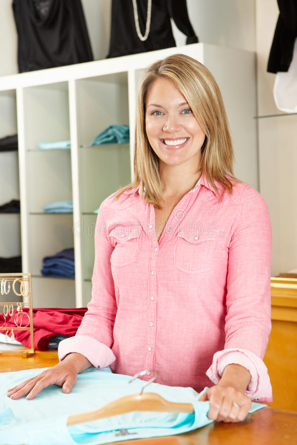 Woman working in fashion store royalty free stock photography
