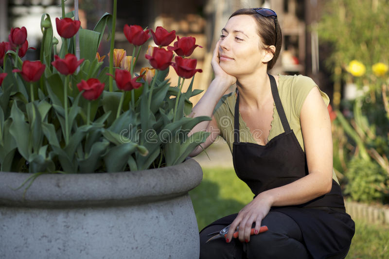 Download Woman working in garden stock photo. Image of summer - 26285360