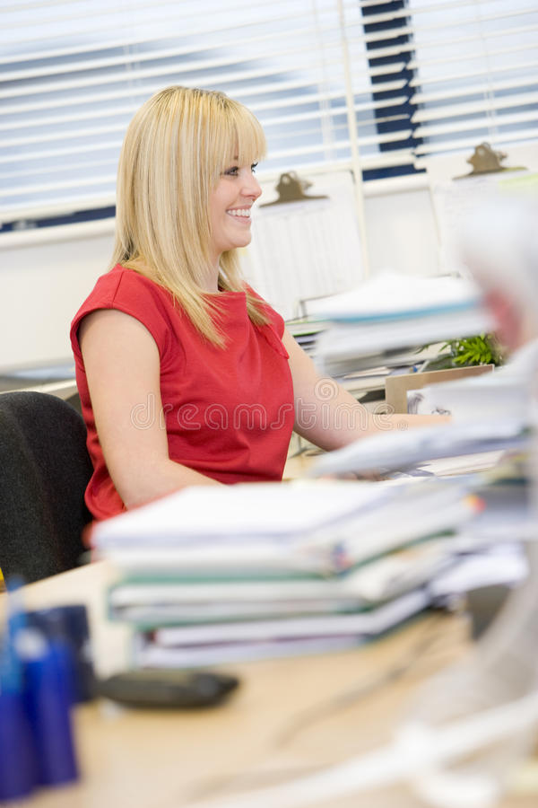 Download Woman Working Happily At Her Desk Stock Photo - Image: 9387674