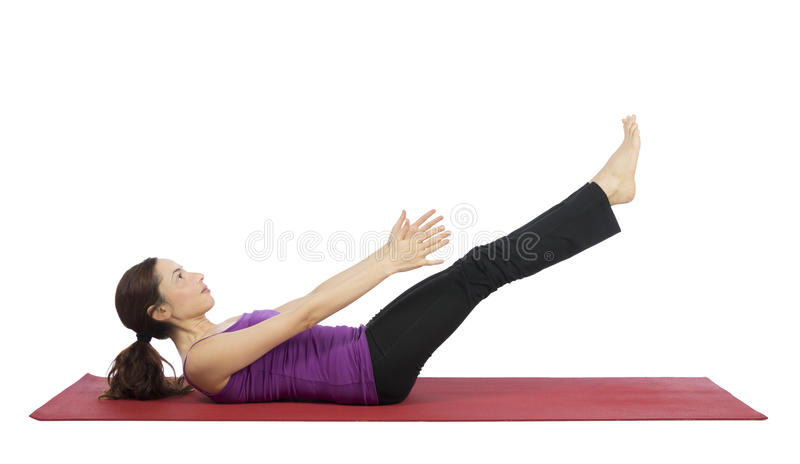Woman working her abs during fitness royalty free stock image