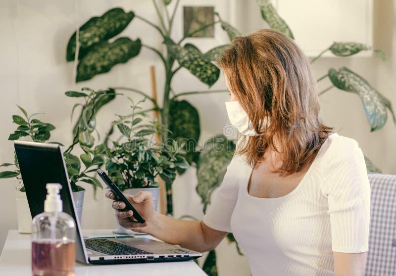 woman working from home - coronavirus stock image