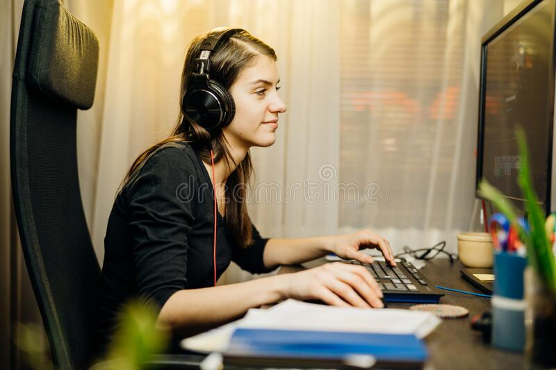 Woman working from home on a desktop computer.Online business career.Freelance remote worker.Productivity and motivation.Video stock images