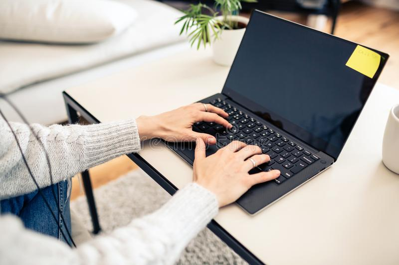 Woman working from home on laptop computer royalty free stock photography