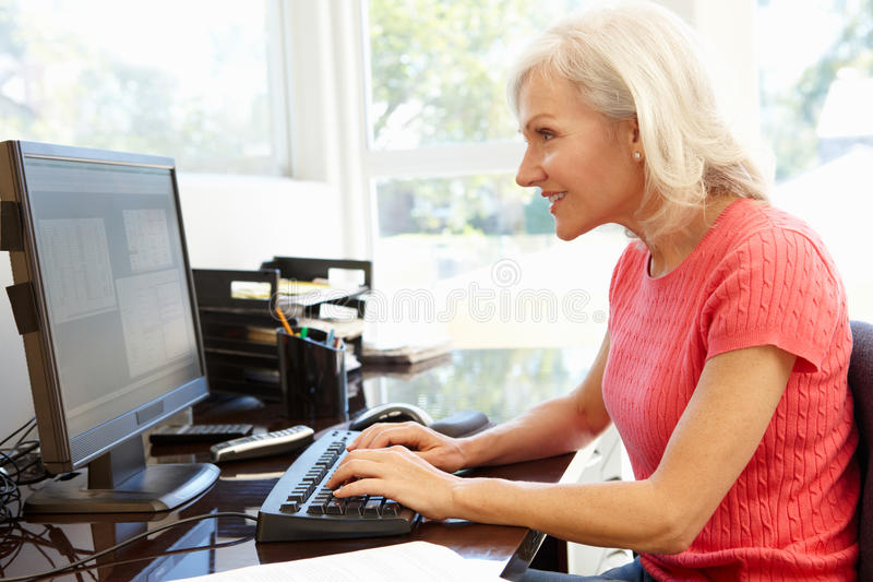 Woman working in home office stock photo