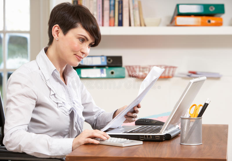 Woman Working From Home Using Laptop. Smiling stock image