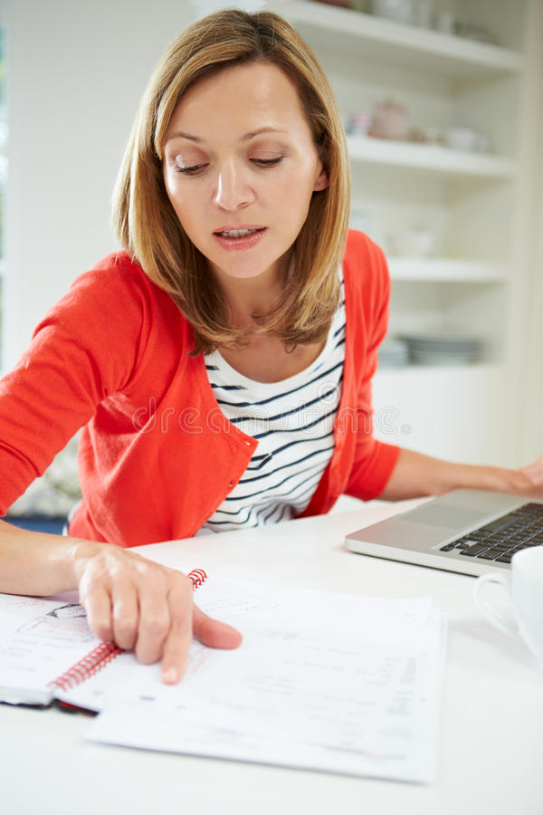 Download Woman Working From Home Using Laptop In Kitchen Stock Photo - Image: 34153826