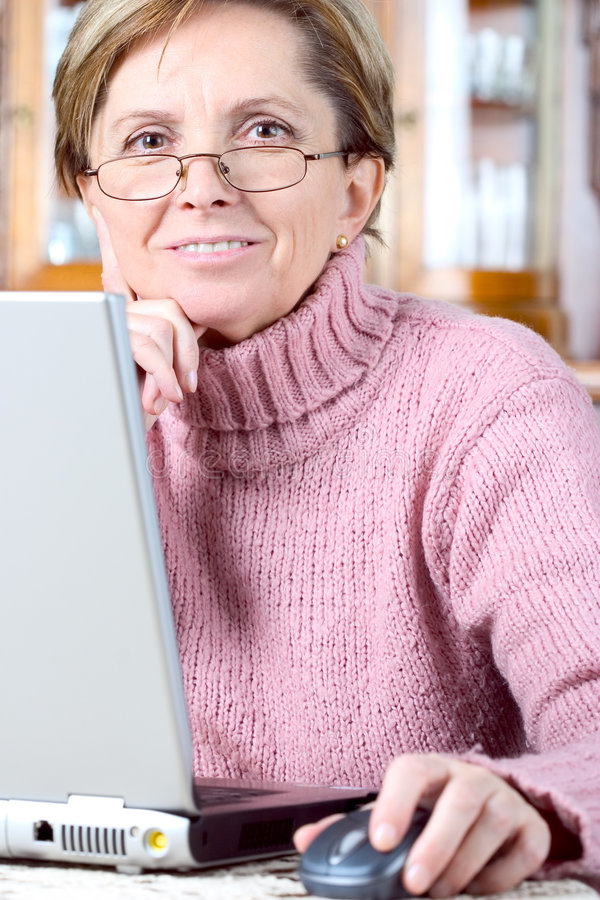 Woman working on laptop royalty free stock image