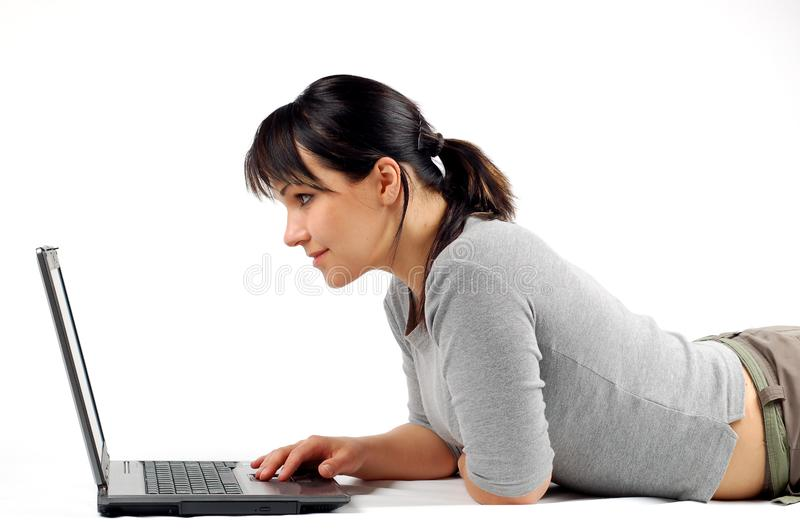 Woman working on laptop #8 stock photography