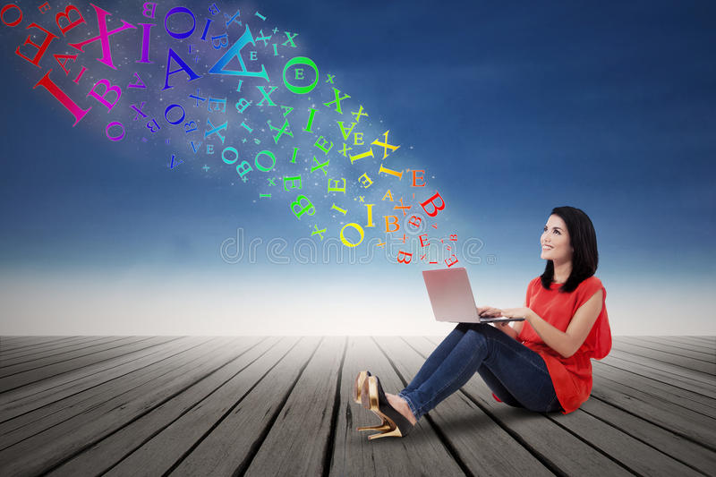 Download Woman Working On Laptop With Alphabet Stock Illustration - Image: 39287041