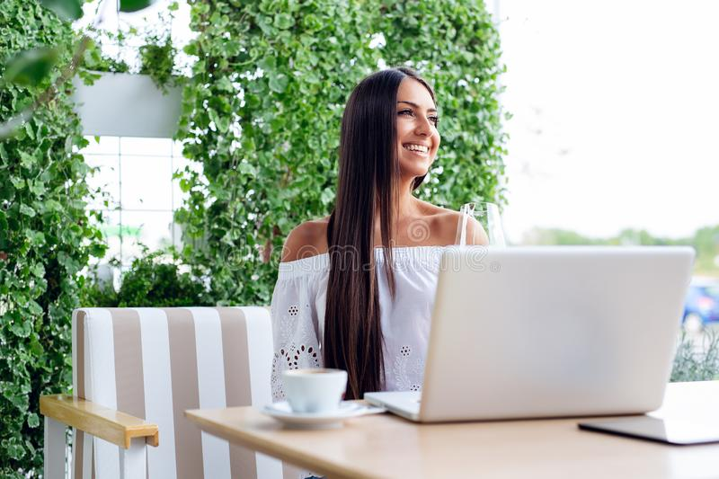 Woman working with laptop in cafe royalty free stock images