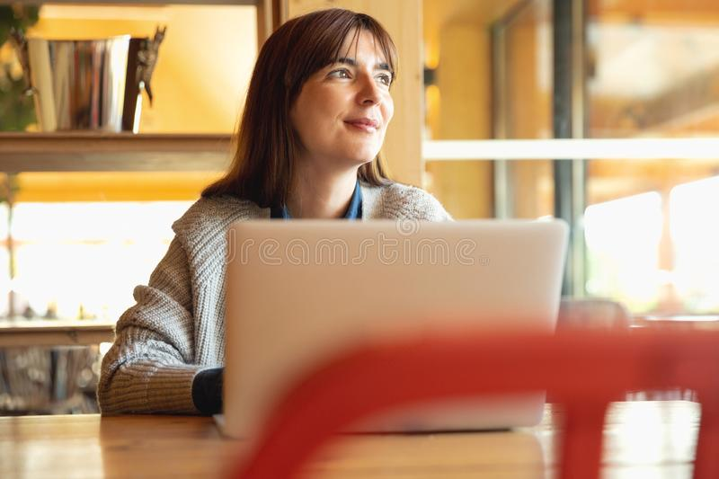 Woman working on a laptop stock image