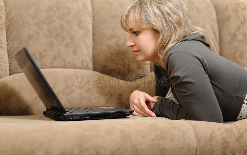 Download The Woman Working On Laptop At Home Stock Photo - Image: 11661322