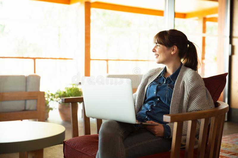 Woman working on a laptop royalty free stock photos