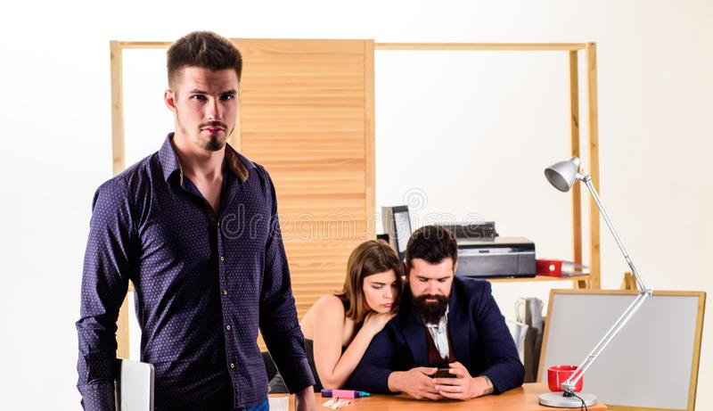 Woman working in mostly male workplace. Woman attractive working with men. Office collective concept. Sexual attraction stock image