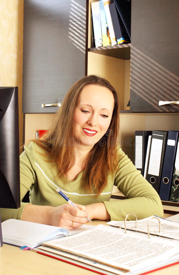 Woman working at the office. royalty free stock photography