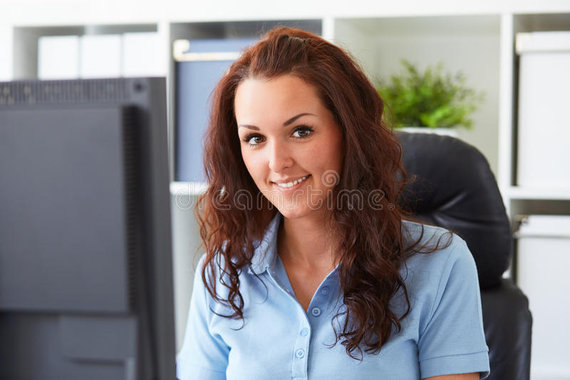 Woman working in the office royalty free stock photo