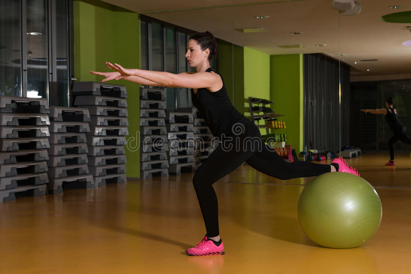 Woman Working Out With Ball In The Gym stock photography
